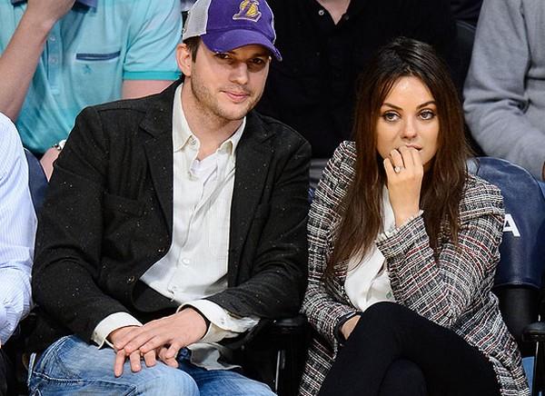 A Newly weeded couple Ashton Kutcher and Mila Kunis