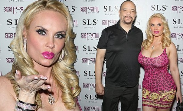 Coco Austin exhibits ample cleavage and curves in skin tight dress