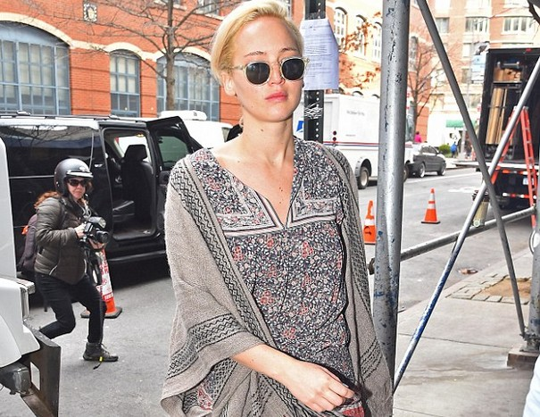 Jennifer Lawrence shows off floral mini dress and long legs