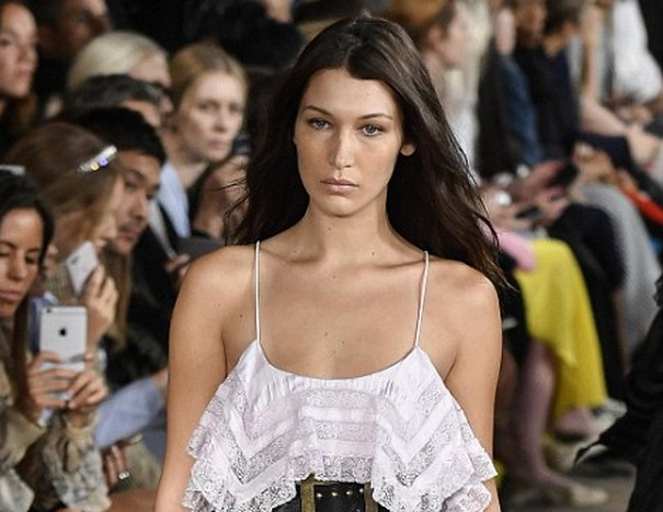 Bella Hadid Braless in sheer lingerie