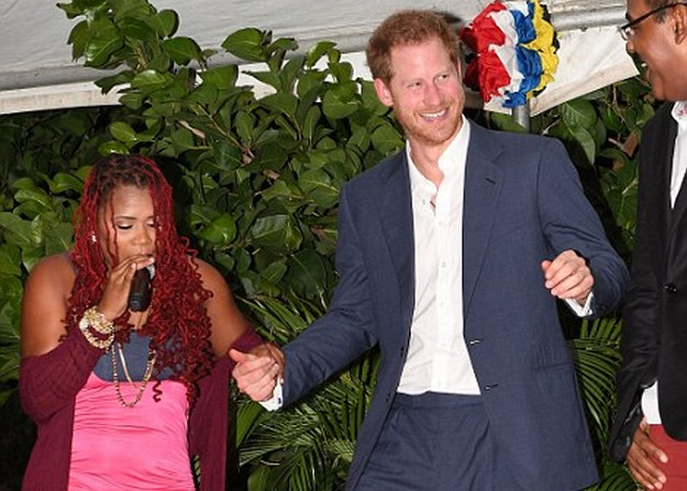 Prince Harry dances with Claudette Peters